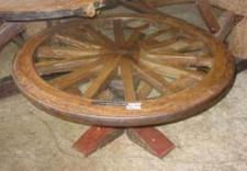 old wagon wheels used in the construction of tables